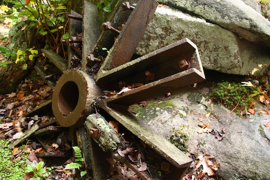 An old grist mill wheel among other artifacts.