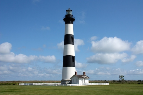 The striking stripes on the brick lighthouse stand out almost as much as the fresnel lens light.