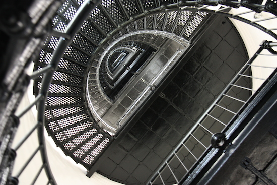 """The spiral staircase has a small """"eyelet"""" at each level where the original chains to make the light turn hung."""