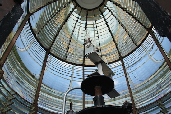 The magnificent first order Fresnel lens still flashes out warnings to mariners from the Bodie Island Lighthouse.