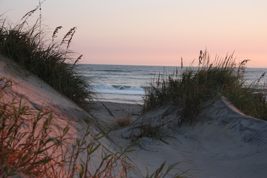 Sunrise over Oregon Inlet dunes behind our campsite.