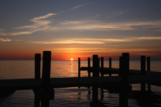 Or ride your bike in to the village and enjoy sunset from the dock.