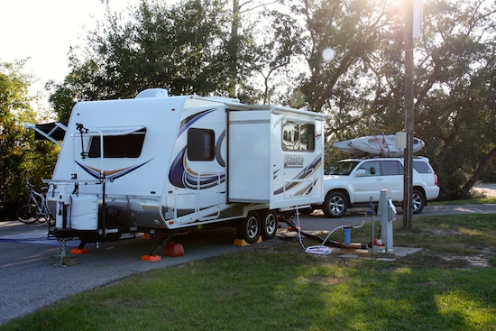 Our pullthrough spot at Gulf State Park Campground, #450 at the end and away from the side by side campsites. Downside? Amongst the big boys with their constant A/C & generators.