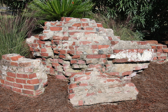 These sample bricks show the amount of cleaning each of the 22,000 bricks required. First they carefully jackhammered the big pieces apart, then chiseled the smaller pieces apart and then individually cleaned each brick. Wow. What an achievement!