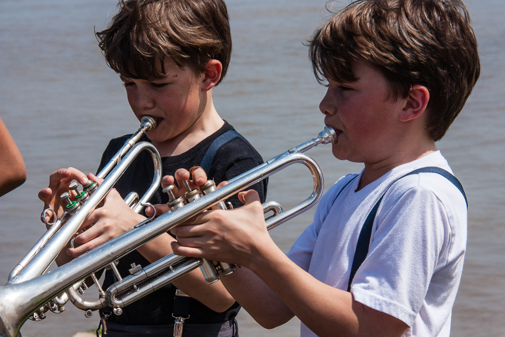 Two young Louie Armstrong hopefuls playing along the Mississippi Riverwalk