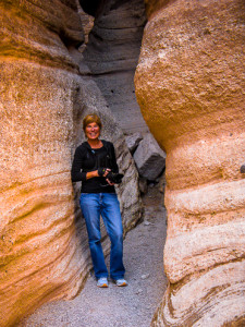 Taking photos in our first slot canyon, a small one in Kasha-Katuwe Tent Rocks National Monument .