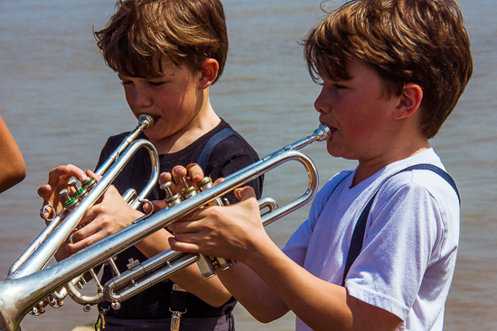 Young NOLA musicians entertain bystanders along the Mighty Mississippi River