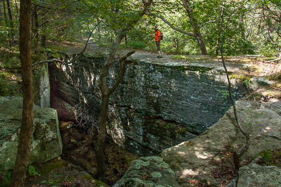 David walks across the Natural Bridge - it's easy to miss and close to the trailhead, so be on the lookout!