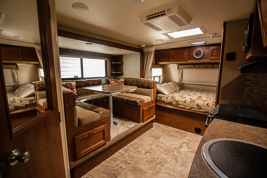 Just LOOK at all that floor space and light! Amazing for a camper only 20' long bumper to hitch.